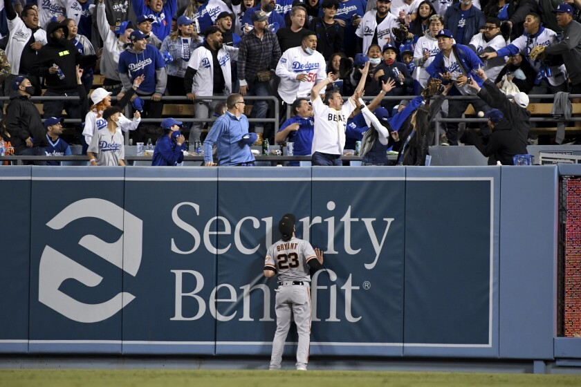 San Francisco Giants right fielder Kris Bryant looks up as fans try to catch a two-run home run.