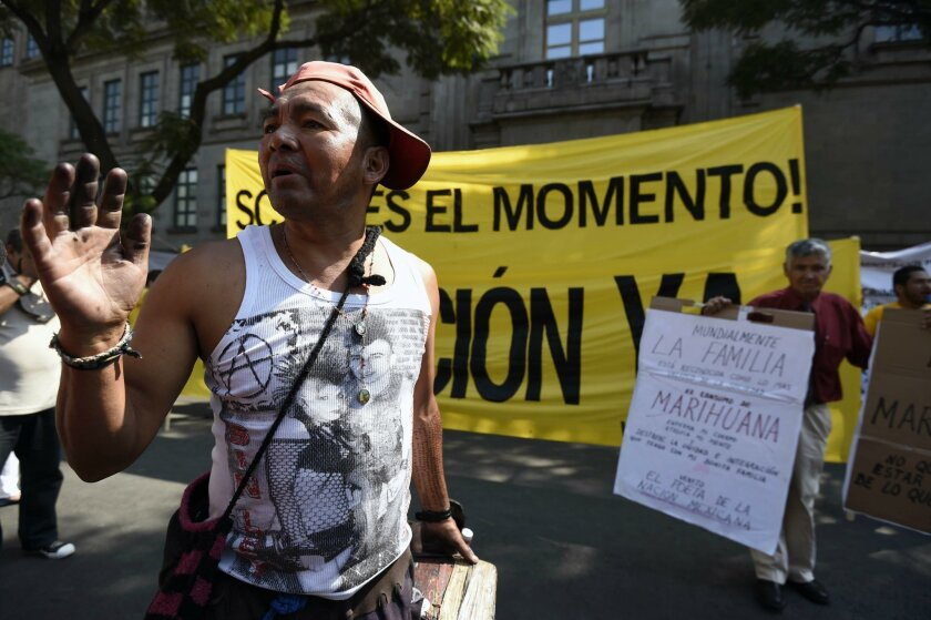 People demonstrate for and against the decriminalization of marijuana in front of the Supreme Court of Justice in Mexico City on Wednesday.