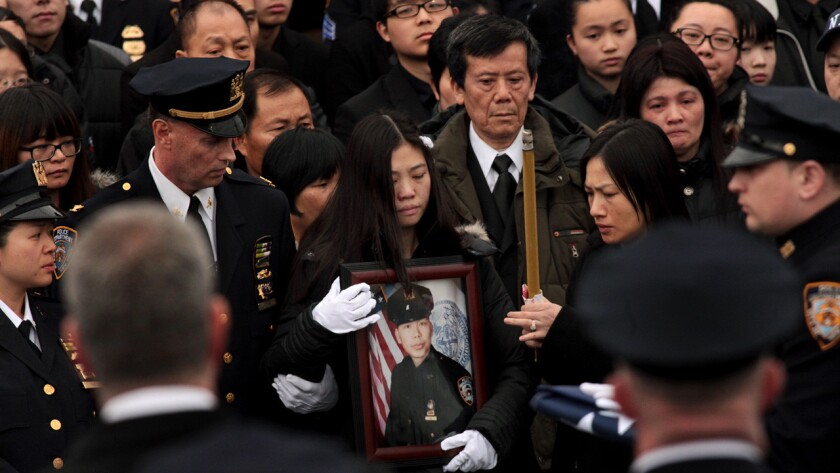 Pei Xia Chen, center, widow of NYPD Officer Wenjian Liu, at his funeral in Brooklyn.