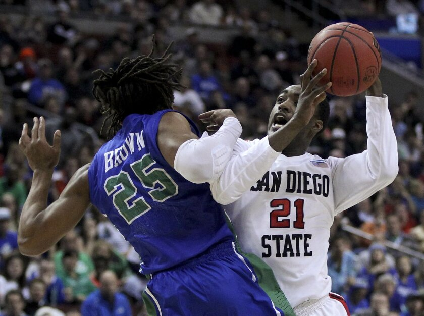 Jamaal Franklin drives to the basket as Sherwood Brown defends in the first half.