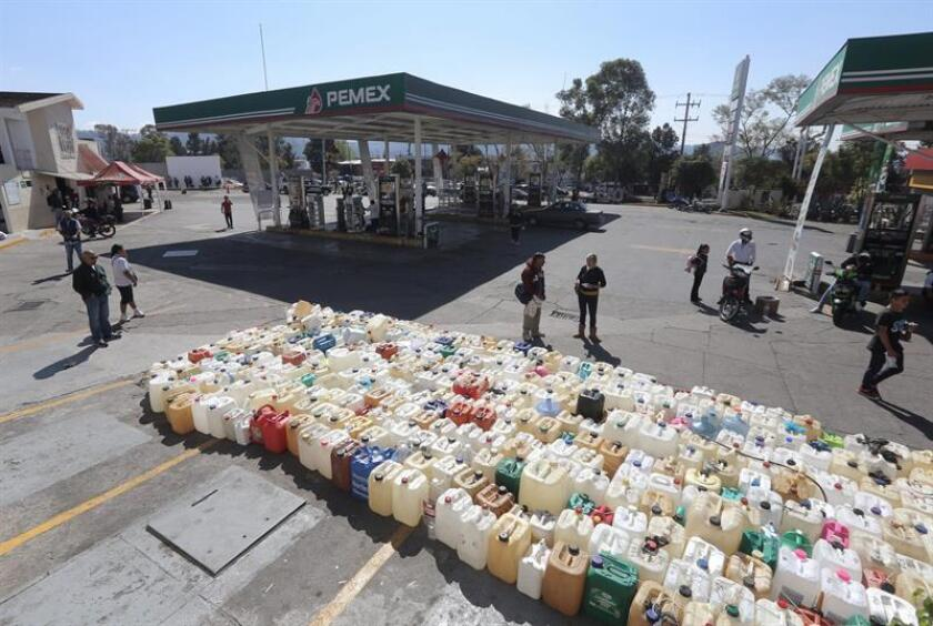 People await a shipment of gasoline at a gas station in the city of Morelia, Michoacan state, Mexico, on Jan. 9, 2018. EPA-EFE/Ivan Villanueva