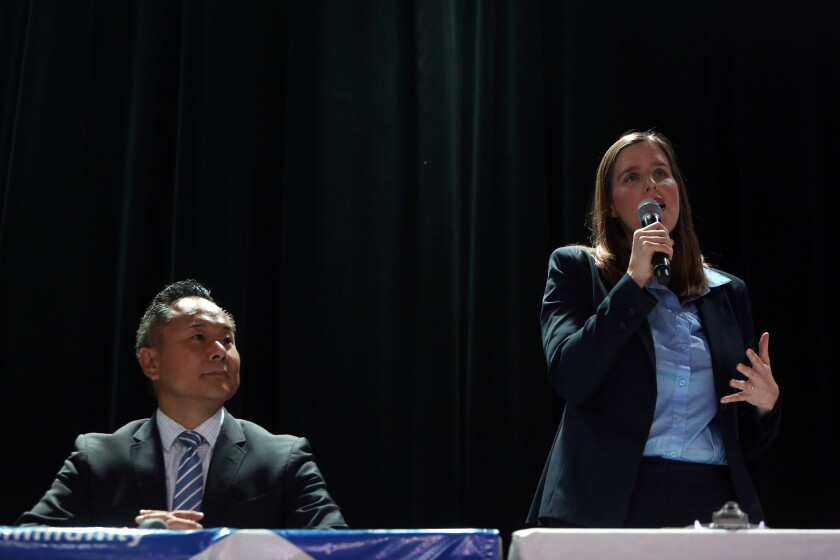 Council candidate Loraine Lundquist, right, and her opponent, now-Councilman John Lee, during a forum in July in Los Angeles.