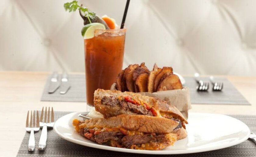Chef Jason Maitland isn't afraid to meaten up his grilled cheese sandwiches, offered Mondays at Flavor Del Mar. (A Bloody Mary is included.)