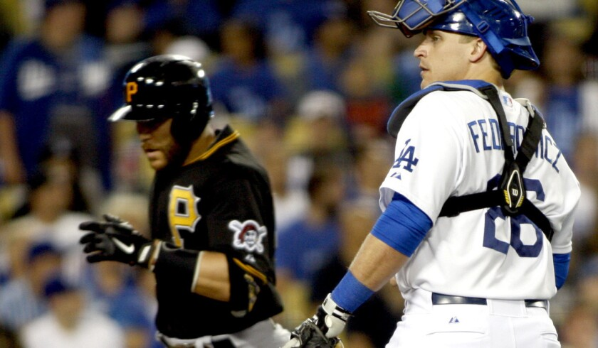 Dodgers catcher Tim Federowicz waits for Pittsburgh's Russell Martin to reach home plate after hitting a solo home run in the sixth inning Thursday night.