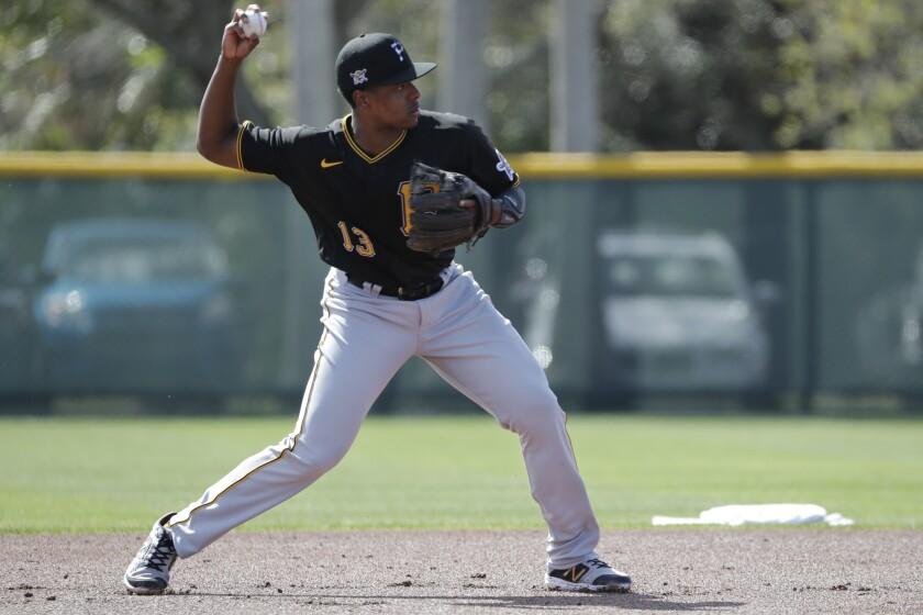 Pittsburgh Pirates' Ke'Bryan Hayes throws to second base during a spring training baseball workout Monday, Feb. 17, 2020, in Bradenton, Fla. (AP Photo/Frank Franklin II)