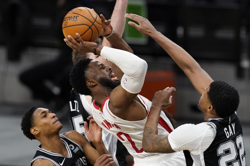 Houston Rockets forward David Nwaba (2) is foiled by San Antonio Spurs forward Rudy Gay (22) as he tries to shoot during the second half of an NBA basketball game in San Antonio, Thursday, Jan. 14, 2021. (AP Photo/Eric Gay)