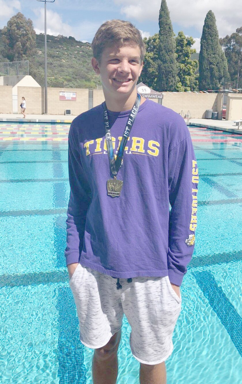 Junior Jacob Nelson earns a first place medal at the 2019 Sundevil Dive Invitational at Mt. Carmel High School.