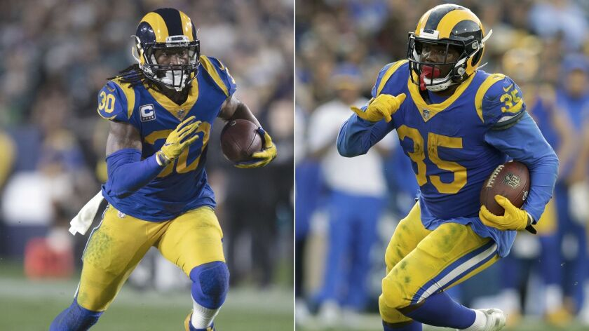 FILE - At left, in a Dec. 16, 2018, file photo, Los Angeles Rams running back Todd Gurley sprints in