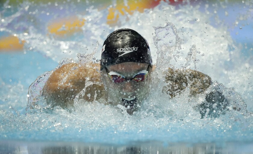 Caeleb Dressel of the U.S. set a world record in the men's 100-meter butterfly semifinals at the world swimming championships Friday in Gwangju, South Korea.