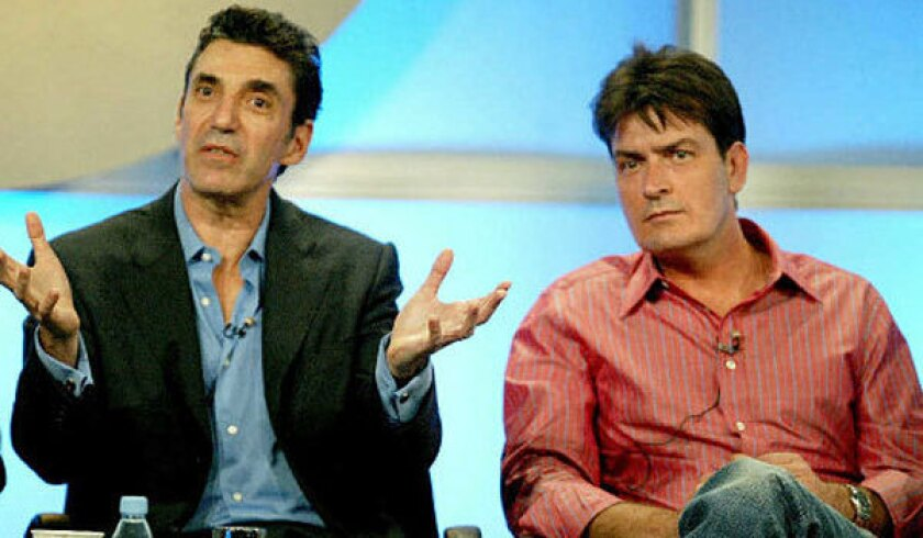 """Chuck Lorre, left, and Charlie Sheen are shown during their time working together on """"Two and a Half Men."""""""