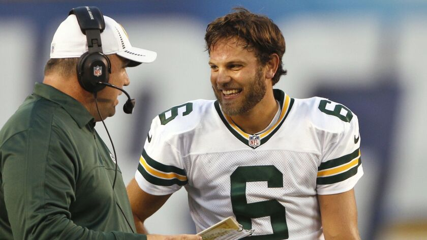 Graham Harrell talks with Green Bay Packers coach Mike McCarthy during a preseason game against the Chargers in 2012.