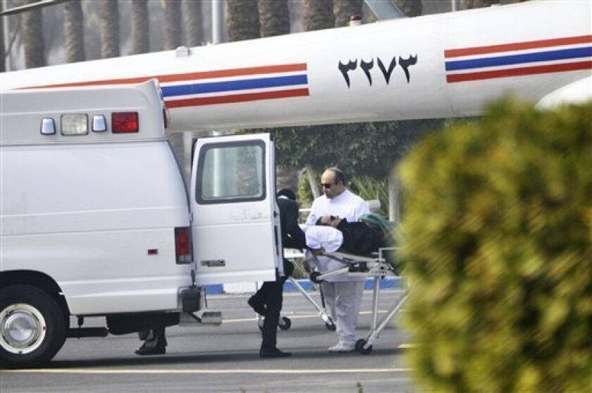"Former Egyptian president Hosni Mubarak is wheeled into a van after attending a trial in Cairo, Egypt, Wednesday, Jan. 4, 2012. The chief prosecutor in Hosni Mubarak's trial accused the ousted Egyptian leader of imposing ""tyrannical rule"" and devoting the last 10 years of his three decades in power to ensure his son would succeed him. (AP Photo/Mohammed al-Law)"