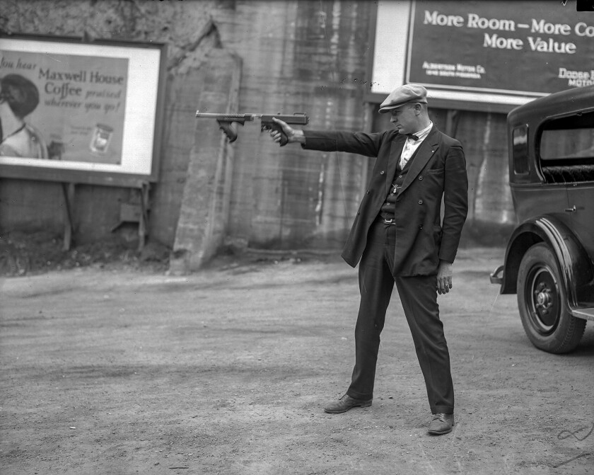 LAPD Det. Lt. Oscar Bayer, the hero of a 1925 shootout, poses in a circa 1927 photo aiming a Thompson submachine gun -- without a magazine.
