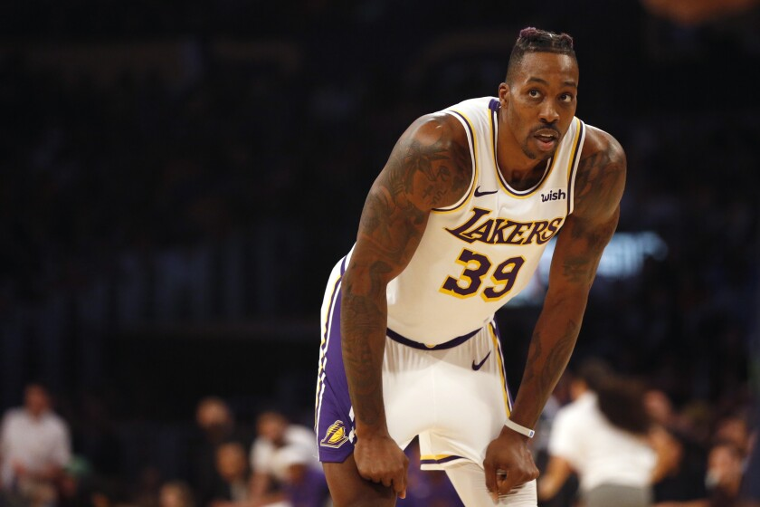 Lakers' Dwight Howard was physical and productive on Tuesday against the Denver Nuggets, scoring 13 points, catching lobs for dunks, collecting six rebounds and blocking two shots.