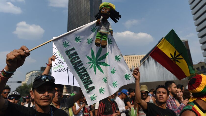 Activists march along Mexico City's Reforma avenue in May to demand the decriminalization of marijuana.