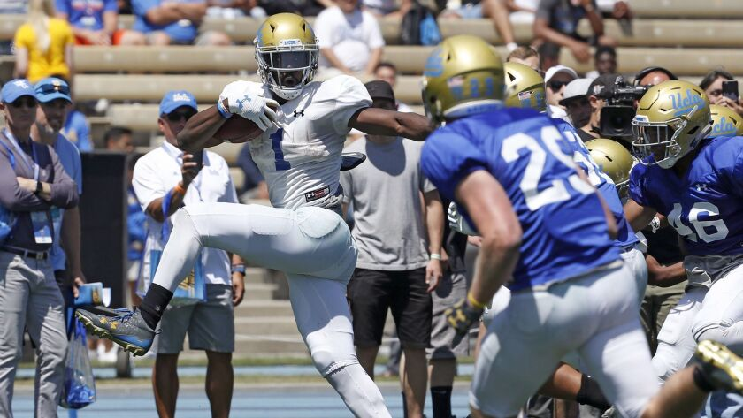 UCLA running back Soso Jamabo breaks free for a long gain during the Bruins' spring football game at Drake Stadium.