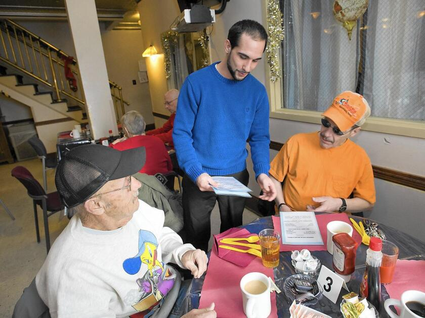Keenan House resident Stephen Coppo (center) takes breakfast orders Raymond Knauss of Allentown (left), and Robert Michaels of Allentown during weekly brunch for the public on Sunday, December 11, 2016. The residents prepare and serve the meal and it's touted as part of the recovery process. //// (HARRY FISHER / The Morning Call) mc-Allentown-Keenan-House-brunch-recovery