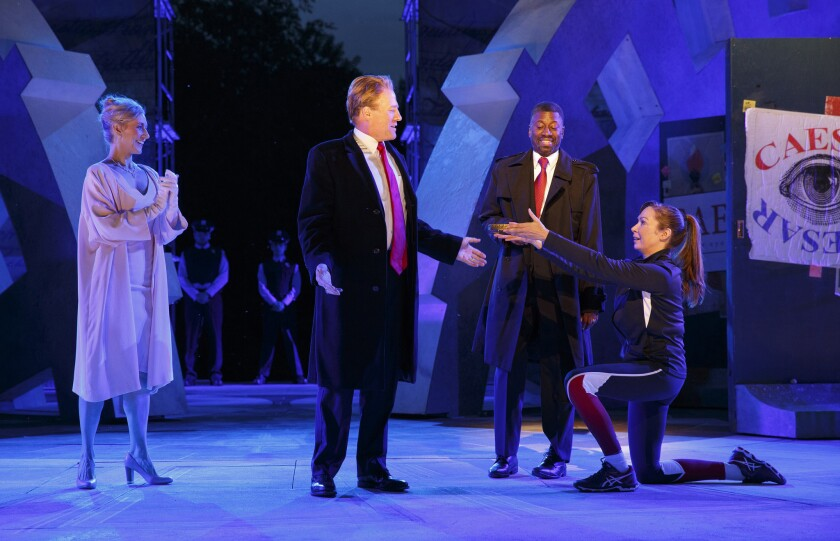 Tina Benko, left, portrays Caesar's wife, Calpurnia, and Gregg Henry, center left, portrays Julius Caesar on May 21.