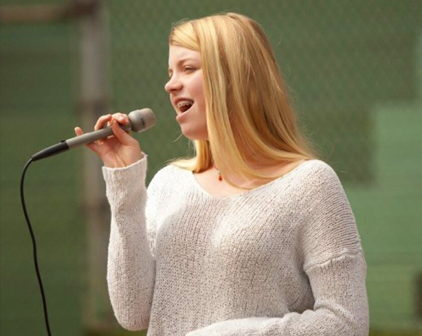 Eighth-grader Sophia Bacino sings the National Anthem.  Her brother, Dominic, plays on Mitch's Surf Shop in Bronco. (La Jolla Youth Baseball, Opening Day Feb. 28, 2015, Cliffridge Park)