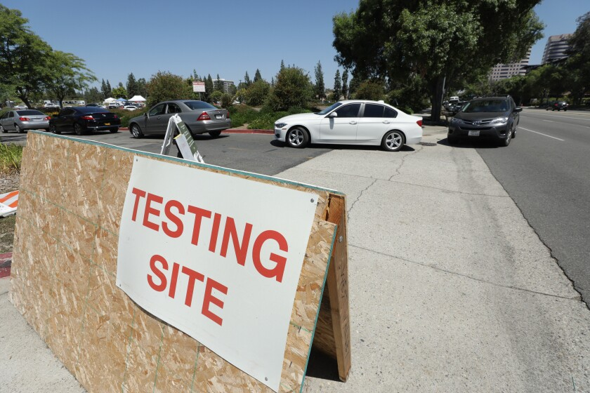 Drivers enter the Warner Center COVID-19 testing location on Monday, July 20, 2020 in Woodland Hills.