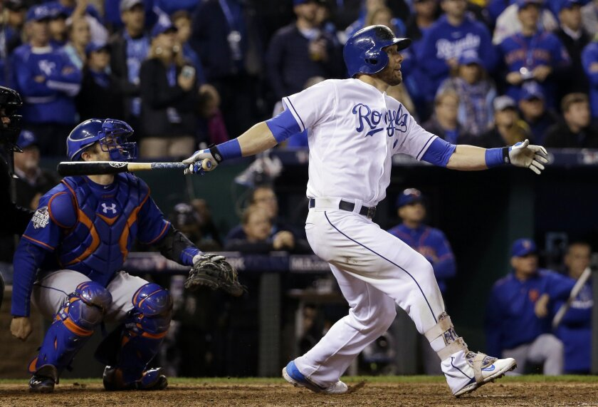 FILE - In this Oct. 27, 2015, file photo, Kansas City Royals' Alex Gordon hits a home run during the ninth inning of Game 1 against the New York Mets, in the baseball World Series in Kansas City, Mo. The All-Star outfielder tested out free agency for the first time in his career, but chose to sign a $72 million, four-year deal to remain where he felt most at home. (AP Photo/David J. Phillip, File)