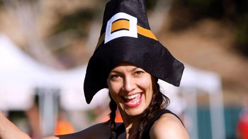 Andrea Filardi of La Cañada Flintridge cheers on wearing a pilgrim hat at the annual Community Cente