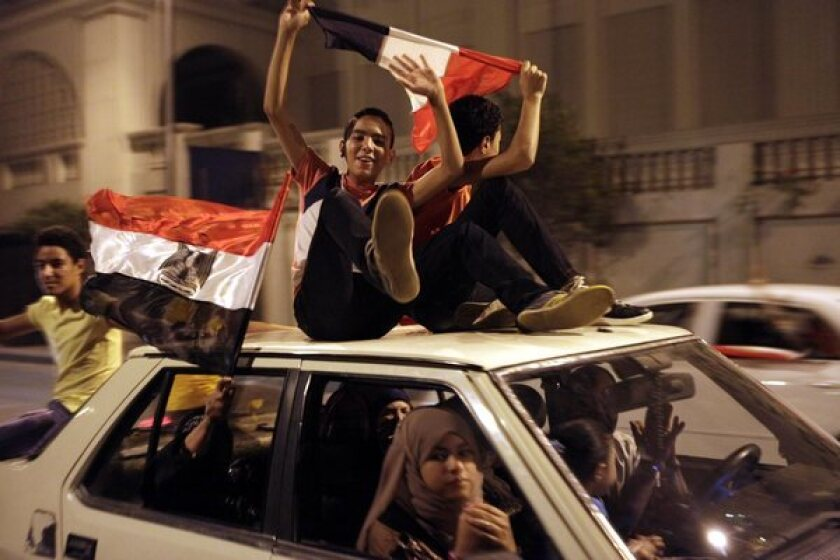 Egyptians celebrate along the Nile in Cairo after the military announced the removal of President Mohamed Morsi.