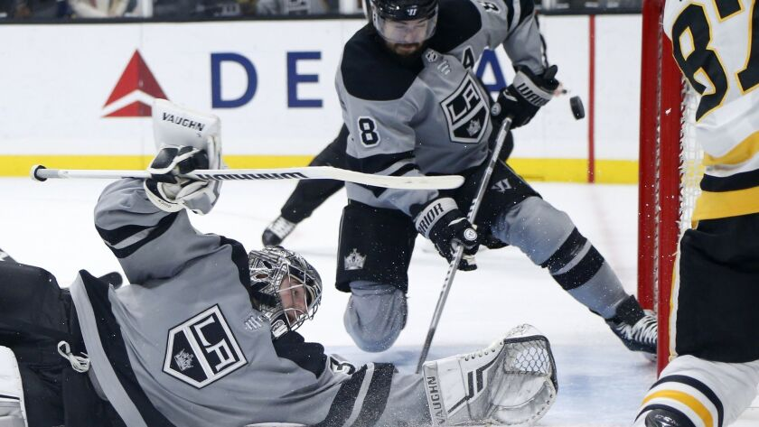 Kings goalie Jonathan Quick makes a save on a shot by Penguins forward Sidney Crosby during the third period.