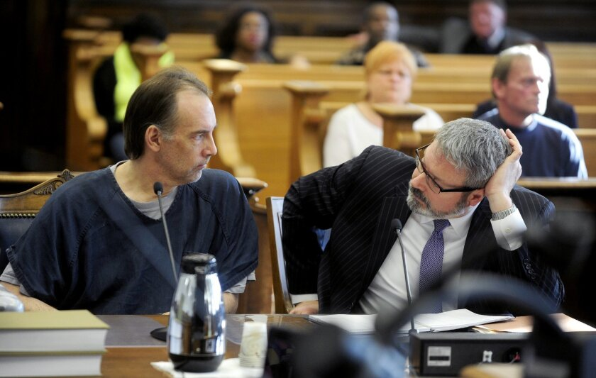 Former police officer Steven Zelich talks to his attorney Jonathan Smith on the first day of his trial in Kenosha, Wis., after pleading guilty to first-degree reckless homicide while using a dangerous weapon and hiding a corpse. Zelich pleaded guilty in the death of 19-year-old Jenny Gamez, of Cottage Grove, Oregon, whose body was found along a Wisconsin highway in August 2012. He will be sentenced in March, and could spend as many as 55 years in prison. (Kevin Poirier/Kenosha News via AP)