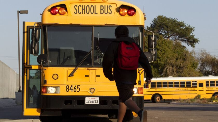 Students board buses at the Creative, Performing and Media Arts Magnet Middle School in Clairemont Mesa which buses 700+ students on 23 buses. Legislature voted today to restore money to the schoo