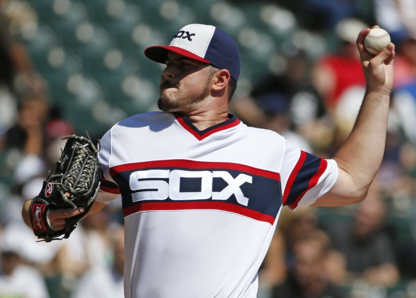 Chicago White Sox starter Carlos Rodon throws against the Seattle Mariners during the first inning of a baseball game in Chicago, Sunday, Aug. 28, 2016. (AP Photo/Nam Y. Huh)
