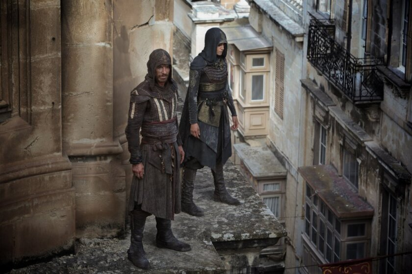 "Michael Fassbender, left, and Ariane Labed in a scene from the movie ""Assassin's Creed."""
