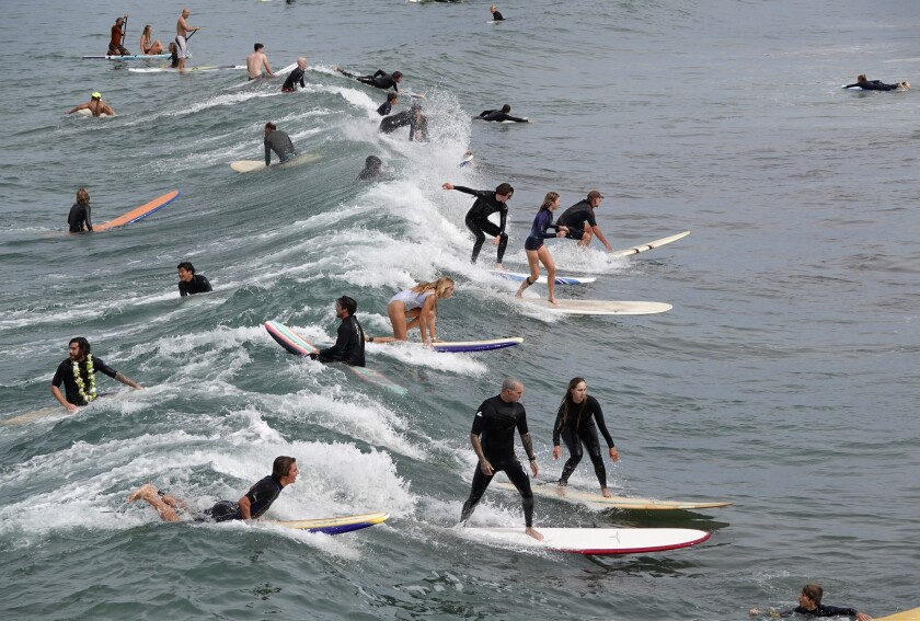 Surfers Catch a Wave at Ocean Beach