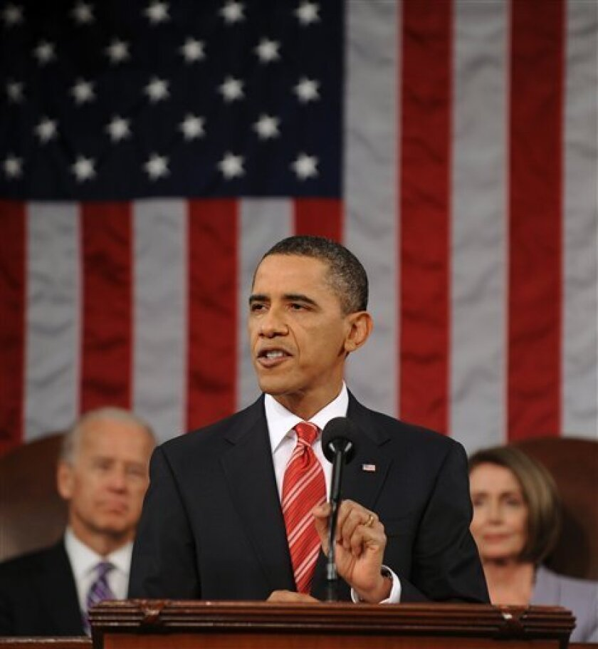 """FILE - In this Jan. 27, 2010, file photo President Barack Obama delivers the first State of the Union address of his presidency on Capitol Hill in Washington. To the joint session of Congress Obama said, """"So, as temperatures cool, I want everyone to take another look at the plan we've proposed... if anyone from either party has a better approach that will bring down premiums, bring down the deficit, cover the uninsured, strengthen Medicare for seniors and stop insurance company abuses, let me know... I'm eager to see it."""" Vice President Joe Biden and House Speaker Nancy Pelosi are seen in the background. (AP Photo/Tim Sloan, Pool, File)"""