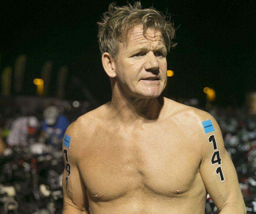 Gordon Ramsay readies his bike at the Ironman World Championship in Kailua-Kona, Hawaii.