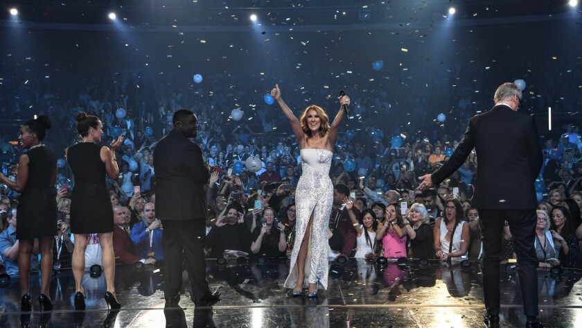 A jubilant Celine Dion is cheered by adoring fans Saturday as balloons and confetti filled the Colosseum during her 1,000th show in Las Vegas.