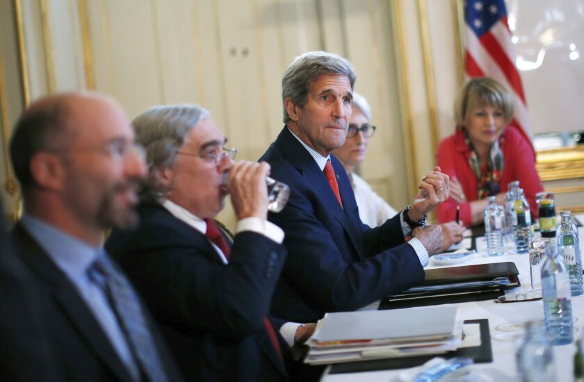 Secretary of State John F. Kerry, center, during nuclear talks with the Iranian foreign minister in Vienna on Friday.