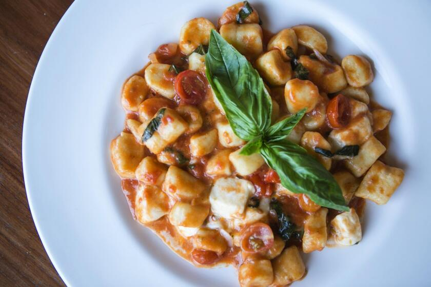 Gnocchi al Telefono: House-made potato gnocchi with cherry tomatoes, fresh basil and mozzarella