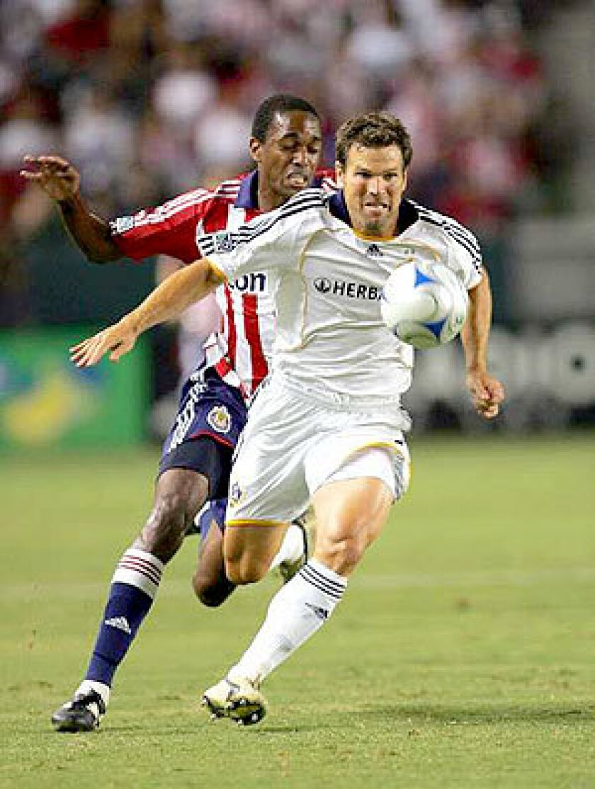 Galaxy defender Greg Vanney battles Chivas USA's Atiba Harris for possession in 2008.
