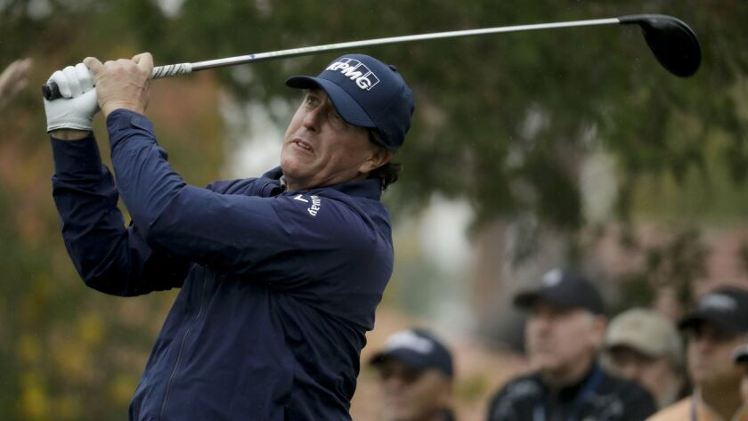 Phil Mickelson watches his tee shot on the fifth hole during the first round of the Desert Classic g