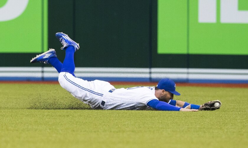 Toronto Blue Jays' Kevin Pillar makes a diving catch against the New York Yankees during the fourth inning of a baseball game Tuesday, May 31, 2016, in Toronto. (Mark Blinch/The Canadian Press via AP)