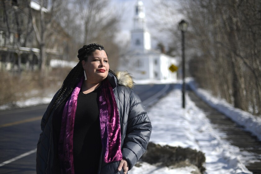 In this Saturday, Feb. 20, 2021, photo, Mia Schultz, president of the Rutland area branch of the NAACP, poses for a picture, in Bennington, Vt. Schultz has watched three other Black women in Vermont resign from leadership posts because of harassment and threats and has seen Black acquaintances move away from the progressive state because they felt unwelcome. (AP Photo/Jessica Hill)