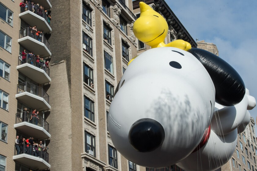 Snoopy balloon with Woodstock at the Macy's Thanksgiving Day Parade