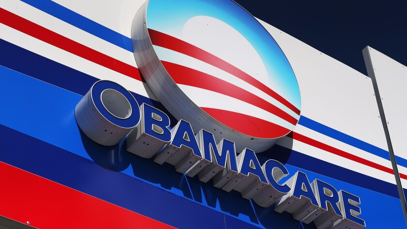 An Obamacare sign is displayed on an insurance company office in Miami last year.