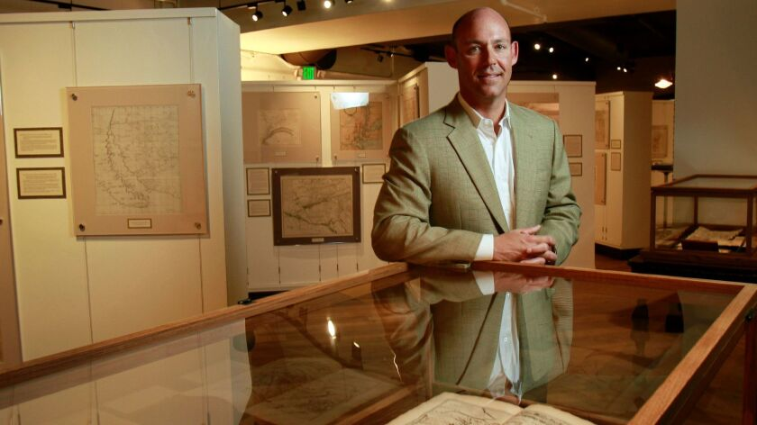 Mike Stone shares some of his prized maps at the Map & Atlas Museum of La Jolla in this 2011 file photo.