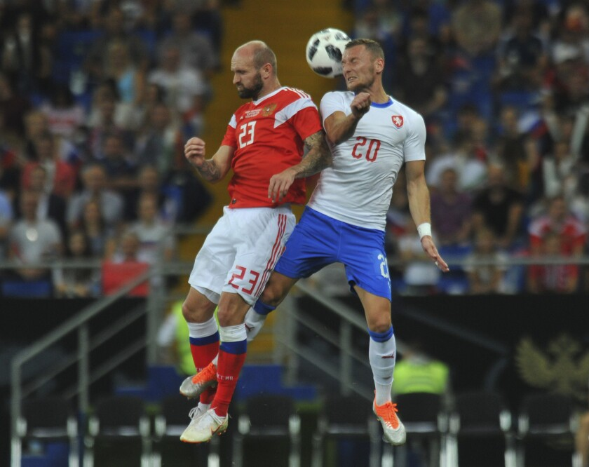 FILE - In this Monday, Sept. 10, 2018 filer, Russia's Konstantin Rausch, left, and Czech Republic's Vladimír Coufal head for the ball during a friendly soccer match between Russia and Czech Republic in the Rostov Arena, in Rostov-on-Don, Russia. (AP Photo/Sergey Pivovarov, File)