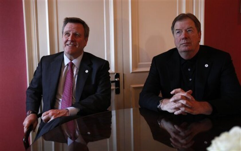 United States Olympic Committee Chairman Larry Probst, right, and USOC CEO Scott Blackmun seen speaking to the Associated Press during an interview at a central London hotel Wednesday, Jan. 11, 2012. U.S. Olympic Committee leaders will resume negotiations with the IOC this week on the revenue-sharing dispute that continues to block any American bid for future games, including a potential candidacy for the 2022 Winter Olympics. USOC chairman Larry Probst and CEO Scott Blackmun told The Associated Press on Wednesday that they will hold talks with International Olympic Committee officials on Friday in Innsbruck, Austria, during the inaugural Winter Youth Games. (AP Photo/Alastair Grant)