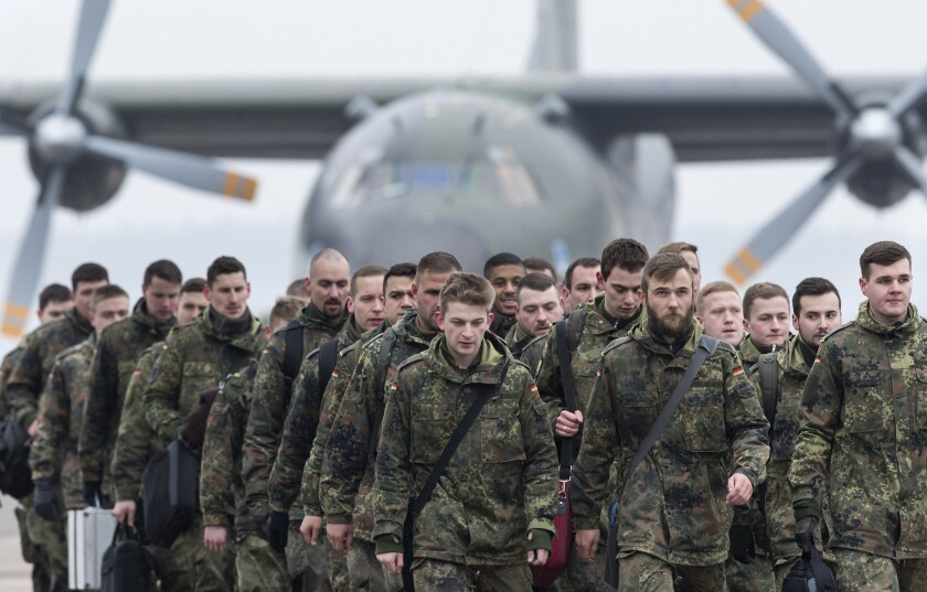 German soldiers arrive Feb. 1 in Lithuania as part of enhanced NATO presence to deter possible Russian aggression.