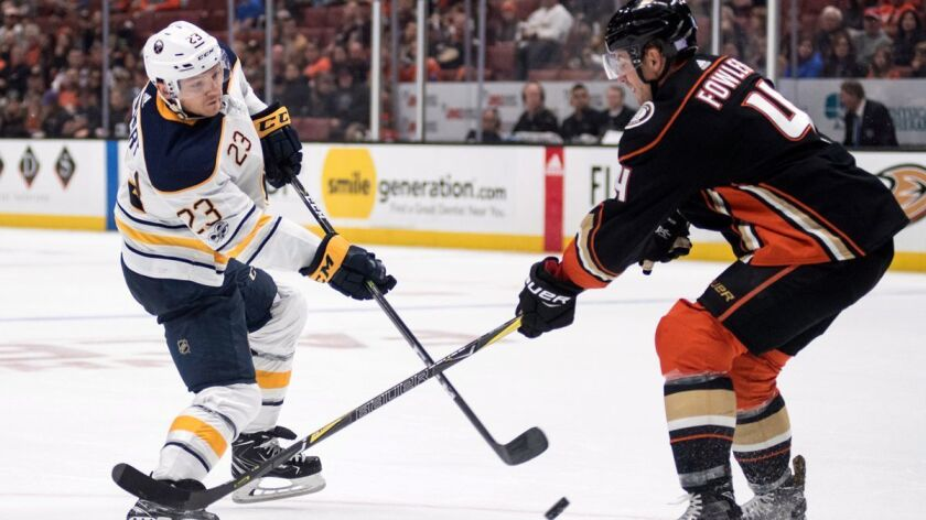 Buffalo Sabres center Sam Reinhart, left, shoots past Ducks defenseman Cam Fowler during a game at Honda Center on Oct. 15.