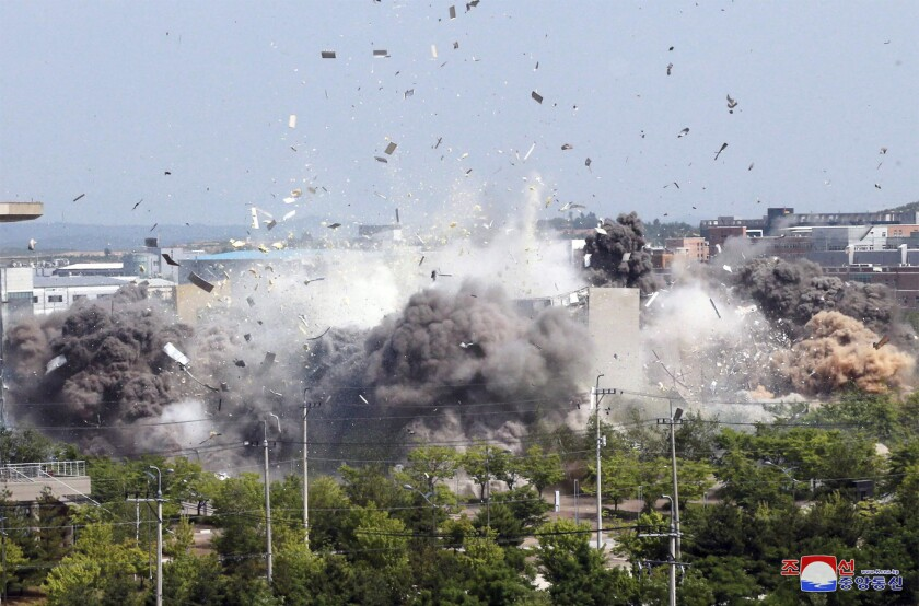 This photo provided by the North Korean government shows the explosion of an inter-Korean liaison office building on Tuesday.